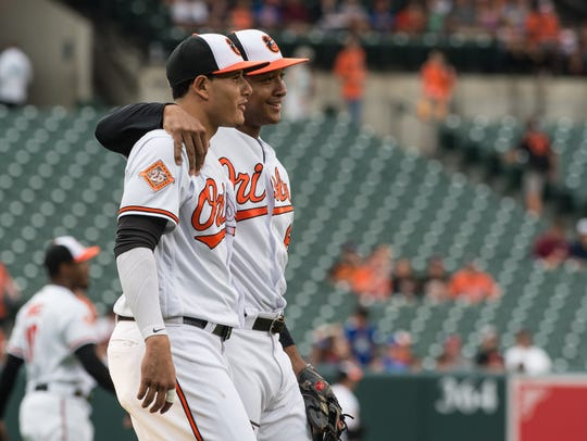 Orioles' third baseman Manny Machado (13) and second