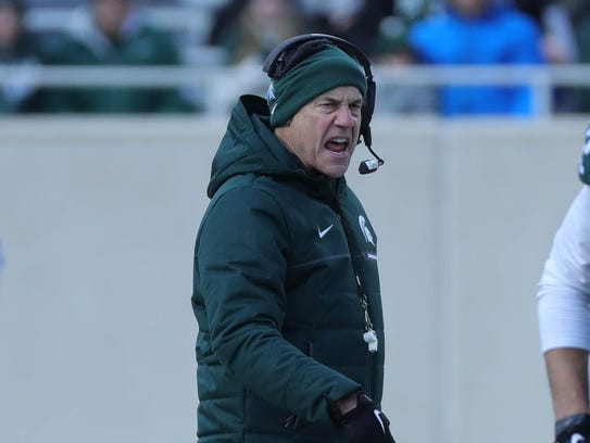 Michigan State head coach Mark Dantonio watches the