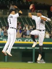Tigers center fielder Leonys Martin, right, and shortstop