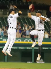 Tigers center fielder Leonys Martin, right, and shortstop Jose Iglesias celebrate the Tigers' 5-2 win over the Twins on Wednesday, June 13, 2018, at Comerica Park.
