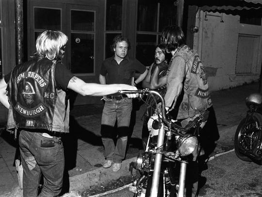 Grim Reapers Motorcycle Club members outside their clubhouse in Newburgh, Ind. in the late 1970's.