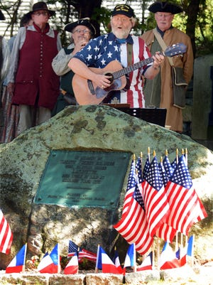 Tom Callinan of Norwich, first state troubadour, sings songs to honor 20 French Revolutionary War sailors who fought the British Tuesday during a ceremony at the Old Norwichtown Burying Ground. See videos and more photos at NorwichBulletin.com.