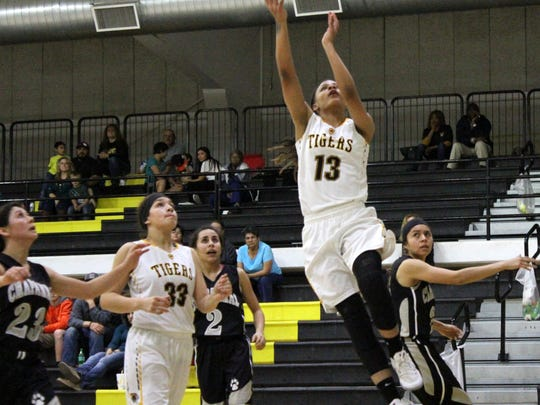Alamogordo's Diavion Hilliard makes an easy layup during the second-half Friday night at the Tiger Pit.