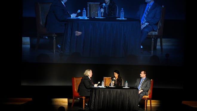 Nadia Murad (center) shares her story about her capture by ISIS and the plight of the Yazidi people in Iraq during a Global Samaritan program April 12, 2017, at the Paramount Theatre.