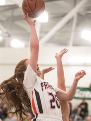Central York's Emma Saxton (20), goes up for a shot