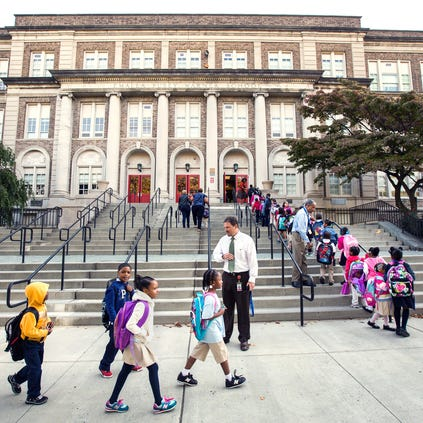 Students file up the stairs to Warner Elementary School on Friday morning, September 19, 2014.