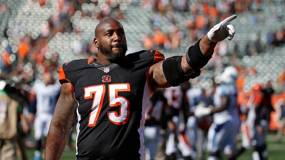 Cincinnati Bengals defensive tackle Devon Still (75) acknowledges fans after their 33-7 win against the Tennessee Titans at Paul Brown Stadium. The Enquirer/Jeff Swinger