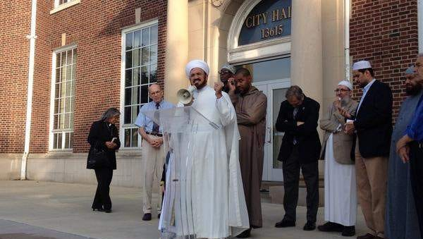 Imam Mohammed Elahi of the Islamic House of Wisdom in Dearborn Heights speaks on the steps of Dearborn City Hall today to condemn militant group ISIS.