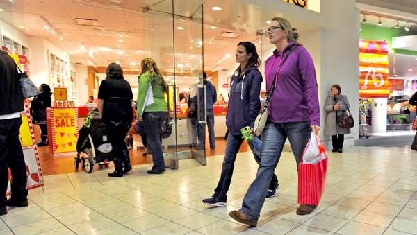 Shoppers walk through The Centre at Salisbury the day after Christmas, one of retail's busiest times of the year for returns and exchanges.