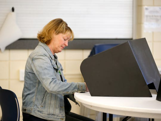 Cathy Moss votes at Precinct 20D at the Price Hill