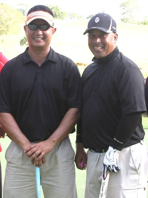 Guam Air National GuardÕs 254th Security Forces SquadronÕs team of Staff Sgt. Louis Sunga, left, and Chief Master Sgt. John Quinata took first place after shooting a 61 in the 2015 TAG Cup Golf Open.