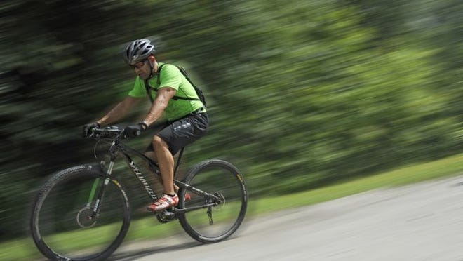 Mark Montague, of Asheville, rides in DuPont State Forest near Brevard in July.