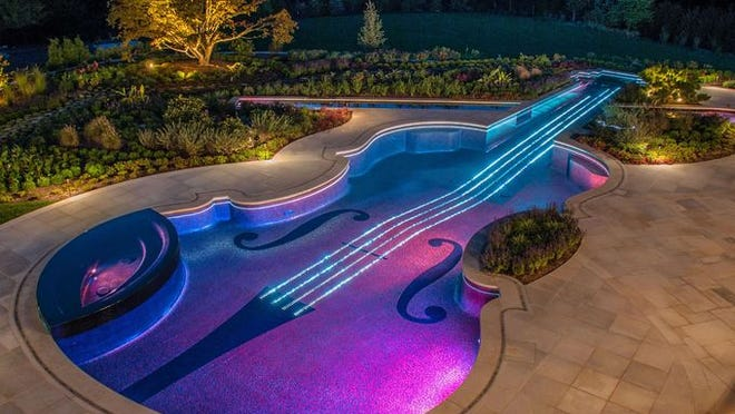 Violin strings represented by 5,760 strands of fiber-optic lighting can be synchronized with music playing externally.