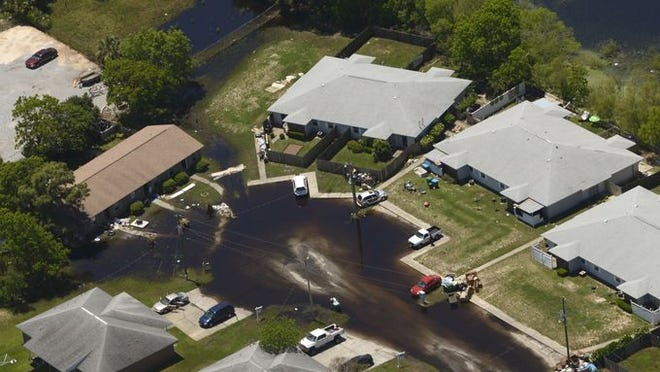 Homes along Bayshore Road in Gulf Breeze show the aftermath of Tuesday's flooding, six days after the storm.