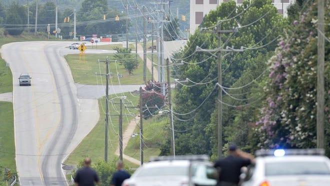 Crews investigate a fatal wreck on Hammett Bridge Road in Greer on Wednesday, July 9, 2014.