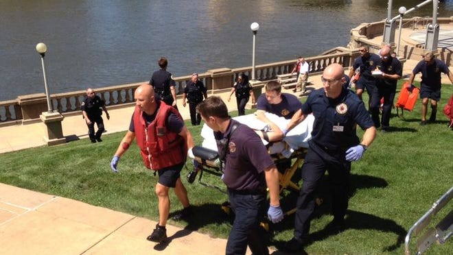 A man was pulled from the Des Moines River near the Simon Estes Amphitheater Wednesday Aug 13, 2014.