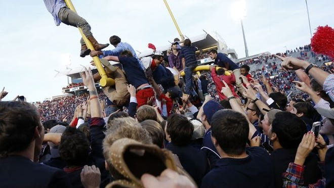 Fans swarm the field at Ole Miss.