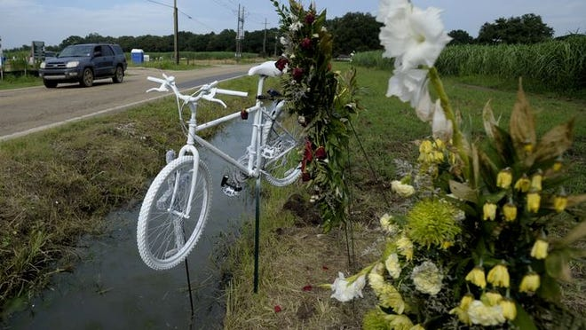 Cyclists from across Acadiana gathered for a memorial bike ride in honor of deceased cyclist Lon Lomas in Youngsville, LA, Sunday, July 13, 2014. Lomas, an avid cyclist, was found dead near the intersection of Mermentau Road and La. Highway 92 after a hit-and-run on Monday.