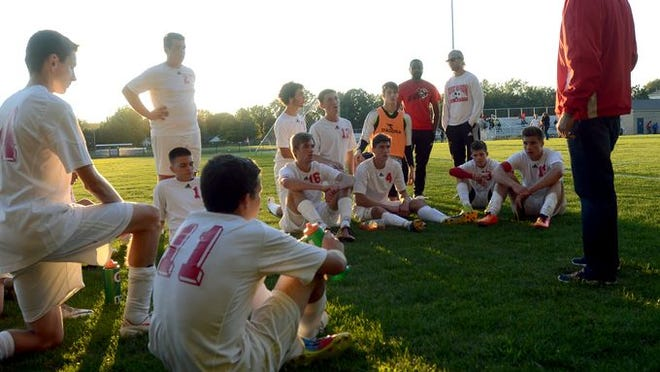 Port Huron head coach Jeremy Rosenau talks with his team before their game against Port Huron Northern on Sept. 22.
