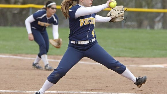 Victor starting pitcher Nicolette Kulakowski winds up her pitch during the first inning of a 6-3 win over Fairport.