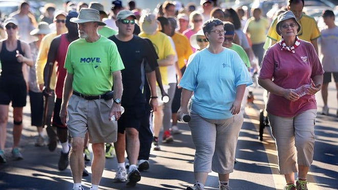 Close to 100 people walked 3.7 miles Saturday during a Move.Tallahassee.com walk in the Jake Gaither Neighborhood.