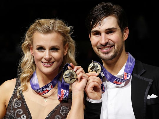 Madison Hubbell, left, and Zachary Donohue pose after winning the free dance event at the U.S. Figure Skating Championships in San Jose, Calif. on Jan. 7, 2018.
