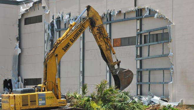 As part of a demolition project, crews this week began tearing down a protective wall installed on Patrick Air Force Base's AFTAC building after the 9/11 attacks. Plans call for 2/3 of the building to be demolished.