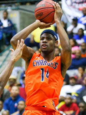 Callaway's Malik Newman (14) shoots against Laurel during MHSAA Boys State Basketball Tournament semifinal action held in Jackson at the Mississippi Coliseum.