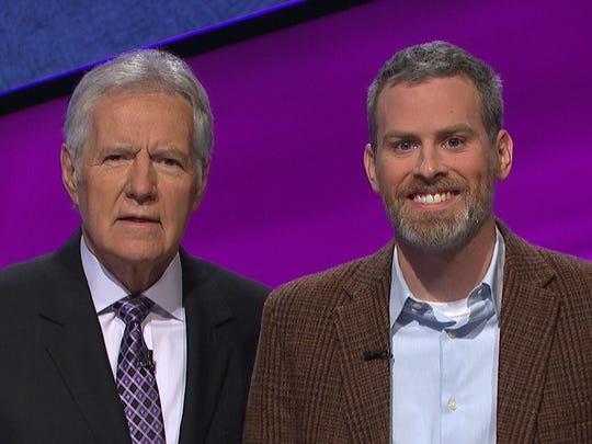 """York College professor Nicolas Anspach (right) poses next to """"Jeopardy!"""" host Alex Trebek."""