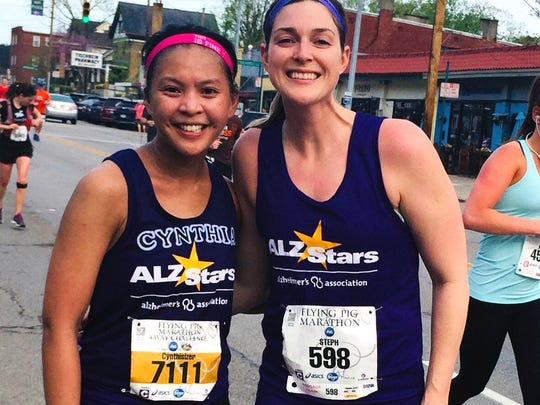 Cynthia Mathias, left, with running partner and ERS coworker Stephanie Antoun. They ran for the Alzheimer's Association of Greater Cincinnati's ALZ Stars Team/Race for The Brain in the Flying Pig Marathon for the company's 20-year anniversary.