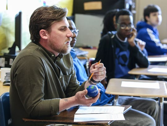 Waggener High School teacher Ben Roberson launches a classroom circle discussion.