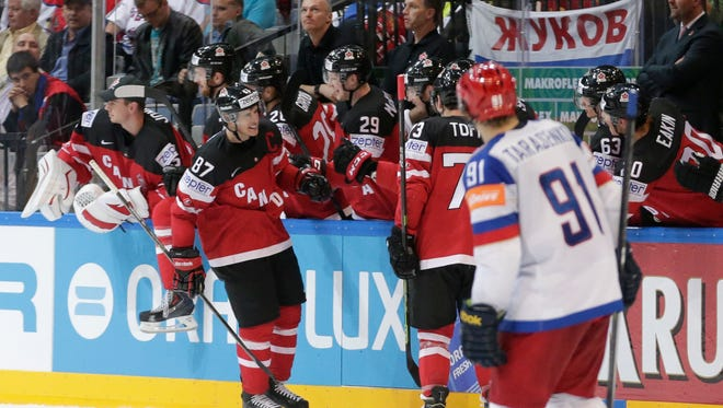 Canada's Sidney Crosby, left, celebrates scoring a goal against Russia during the Hockey World Championships gold medal match in Prague, Czech Republic, Sunday, May 17, 2015.
