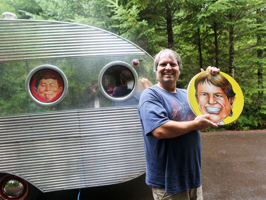 Bob Gallagher of Keizer with his rare1955 Airflow trailer, complete with circular windows and custom covers. Vintage trailer aficionados gather at River Bend County Park on the South Santiam River east of Sweet Home.
