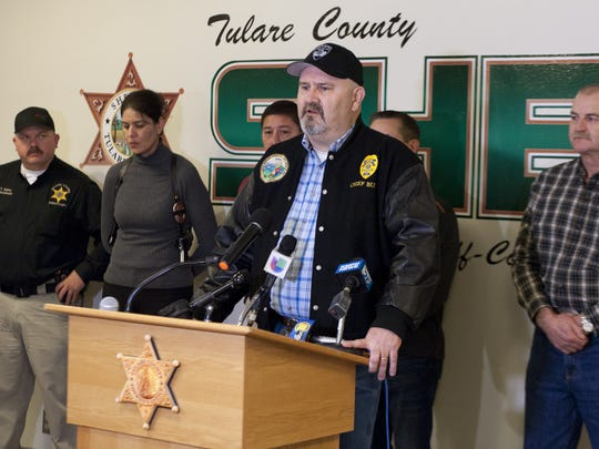 Exeter Police Chief Cliff Bush speaks to the media after the announcement of Erika Sandoval's arrest on Saturday, February 7, 2015 in connection with the homicide of Exeter police officer Daniel Green.