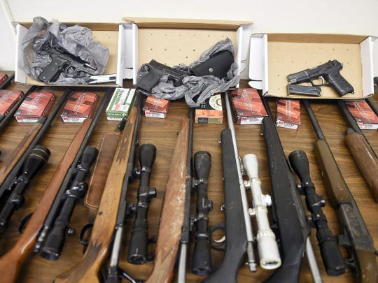 In addition to drugs, police confiscated guns, cars and cash in the drug bust.