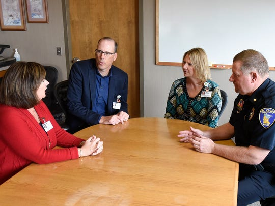 St. Cloud Police Department Commander Jim Steve talks with hospital officials Beth Honkomp, left, Kurt Otto and Joy Plamann about security changes Friday, Oct. 14, at the St. Cloud Hospital.