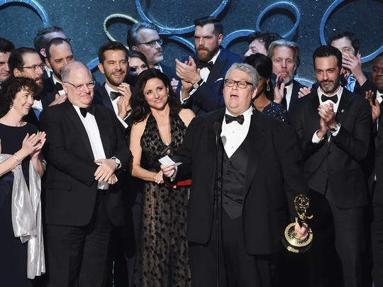 """Actress Julia Louis-Dreyfus, producer David Mandel (both center) and production team accept Outstanding Comedy Series for """"Veep"""" onstage during the 68th Annual Primetime Emmy Awards at Microsoft Theater."""