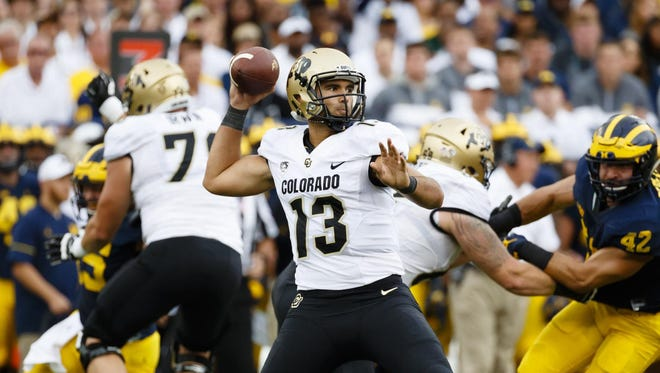 Sefo Liufau was 16-for-25 for 246 yards and three touchdowns before suffering a right ankle injury in the third quarter. After another set of downs, he didn't return.