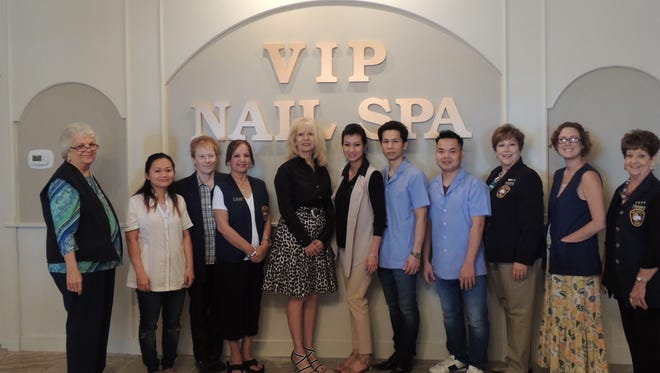 San Angelo Mayor Brenda Gunter and the staff of VIP Nail Spa join the Concho Cadre as they prepare to cut the red ribbon May 31, 2017, at 2011 Knickerbocker Road.