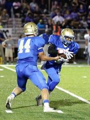 Huntingdon quarterback Kade Pearson hands the ball