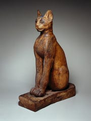 """Divine Felines"" exhibit at the McClung Museum includes this ""Figure of a Cat"" made of materials that include sycamore and fig wood, gilded gesso, bronze, copper, pigment, rock crystal and glass. This  exhibition is  organized by the Brooklyn Museum."