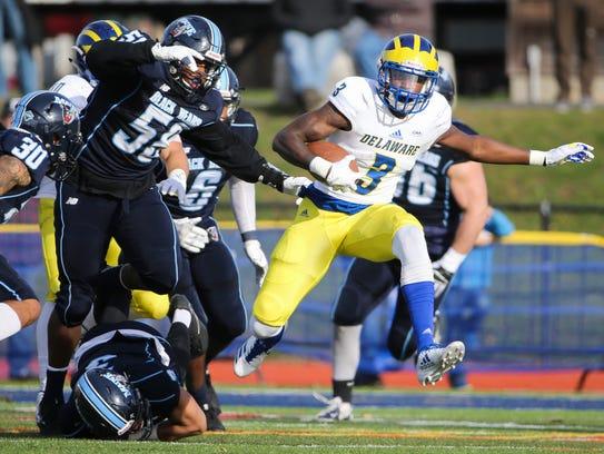 Delaware quarterback Joe Walker winds his way past