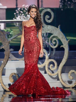 Miss USA Nia Sanchez competes onstage during the evening gown competition at the 2014 Miss Universe show at the FIU Arena in Miami.