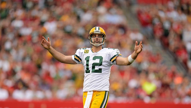 Green Bay Packers quarterback Aaron Rodgers (12) reacts after the Packers nearly scored a touchdown against the Tampa Bay Buccaneers in the fourth quarter during Sunday's game at Raymond James Stadium in Tampa, Fla.