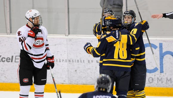 Quinnipiac players celebrate their first goal of the