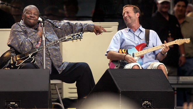 B.B. King, left, jokes around with Eric Clapton during a jam session at the Cotton Bowl at the Eric Clapton Crossroads Guitar Festival, Sunday, June 6, 2004, in Dallas. (AP Photo/Tony Gutierrez)
