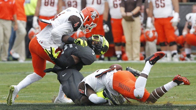 Domonique Young can't come up with the reception as he is hit by Bowling Green's Eilar Hardy at 13:21 in the second quarter Saturday, September 26, 2015, at Ross-Ade Stadium. Hardy was whistled for targeting and was ejected from the game. Bowling Green defeated Purdue 35-28.