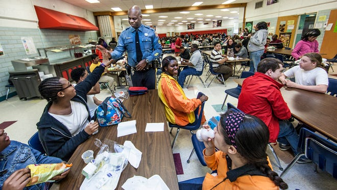William Penn High School's school resource officer, Cpl. Rich Collins, interacts with students during a lunch period in 2013.