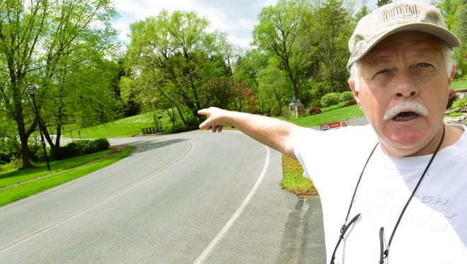 Steven Gray talks about safety issues Monday, May 2, 2016 that he thinks should make him exempt from placing sidewalks in front of his Limekiln Drive property. The Borough of Chambersburg requires sidewalks on both sides of the street in that area.
