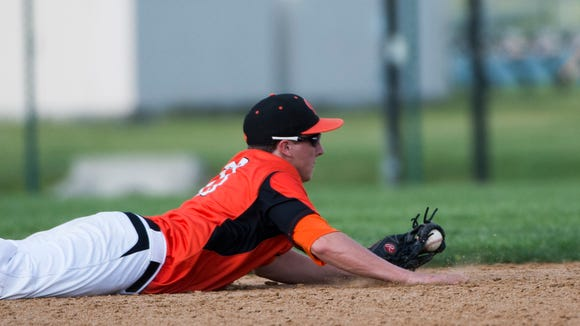 Palmyra's Brandon Charochak makes a diving catch but is unable to hold onto it for the out as Palmyra defeated West York 7-3 in the first round of the PIAA District III AAA tournament on Tuesday, May 24, 2016.